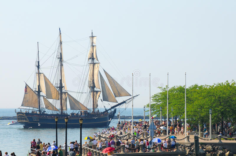 Crowds see Bounty. The H.M.S. Bounty (1962 replica) sails past crowds watching the Parade of Ships that began the 2010 Cleveland Tall Ships Festival (July 7-12) royalty free stock image