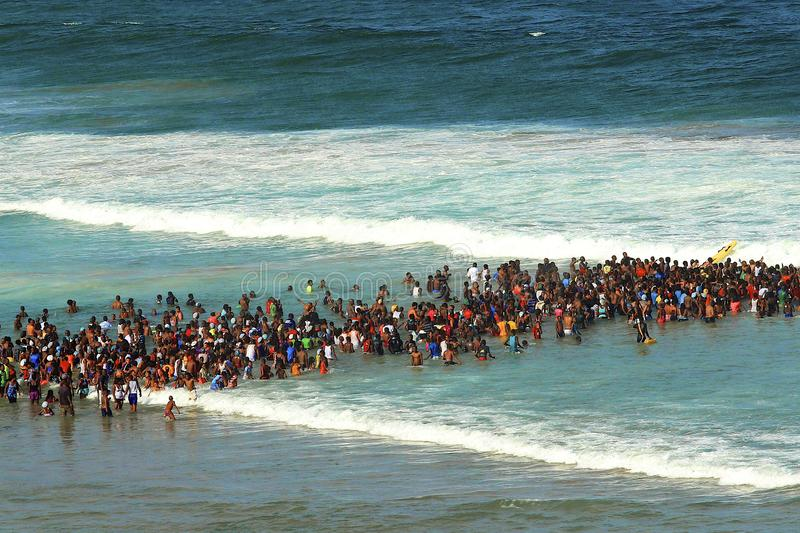 Swimming on the beach in Durban, South Africa. Crowds swimming on the beach in Durban, South Africa - New Year holidays stock photo