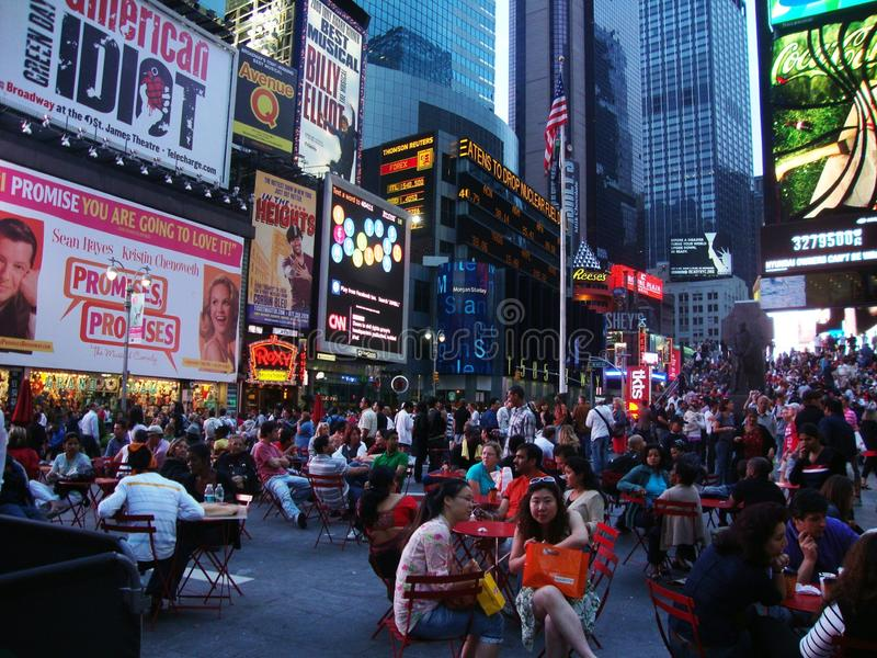Crowds at times square. Times Square is a major commercial intersection, tourist destination, entertainment center and neighborhood in the Midtown Manhattan royalty free stock image