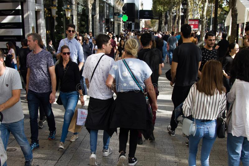 Crowds of tourists and citizens on the streets of the French capital in the autumn. Paris, France - September 23, 2017: Crowds of tourists and citizens on the royalty free stock images