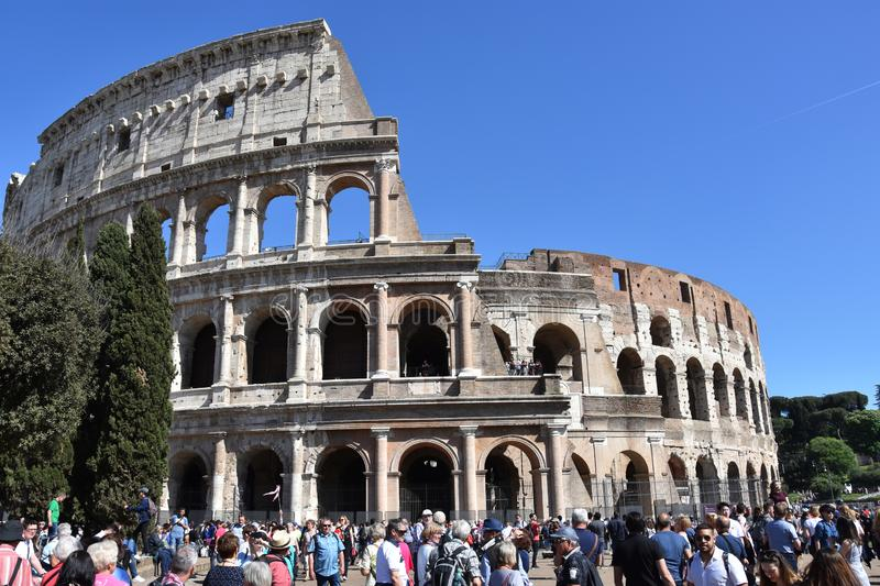 Crowds of tourists at Colosseum in Rome royalty free stock image