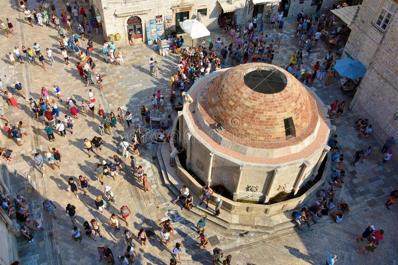 Crowds of tourists at Onofrio fountain in the historical center of Dubrovnic. Aerial view of one  of Dubrovnik's most famous landmarks, the Onofrio royalty free stock image