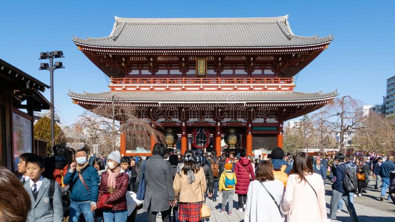 Crowds of tourists visit Sensoji Temple in Asakusa prefecture, Tokyo. Senso-ji Buddhist temple is dedicated to the bodhisattva stock photos