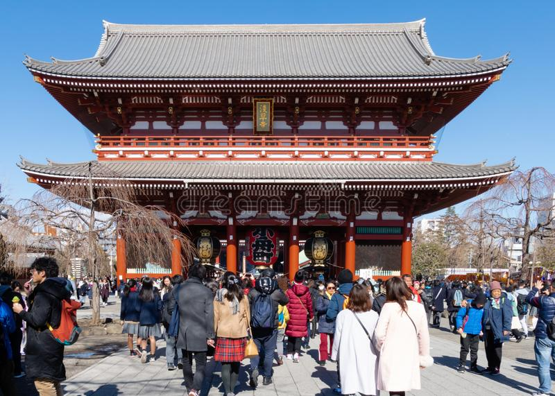 Crowds of tourists visit Sensoji Temple in Asakusa prefecture, Tokyo. Senso-ji Buddhist temple is dedicated to the bodhisattva royalty free stock images