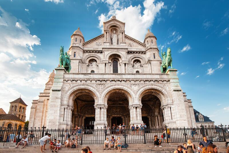 Crowds of tourists walking near Basilique du Sacre Coeur, on hilltop of Montmartre. Famous travel. 25 July 2019, Paris, France: Crowds of tourists walking near royalty free stock photography