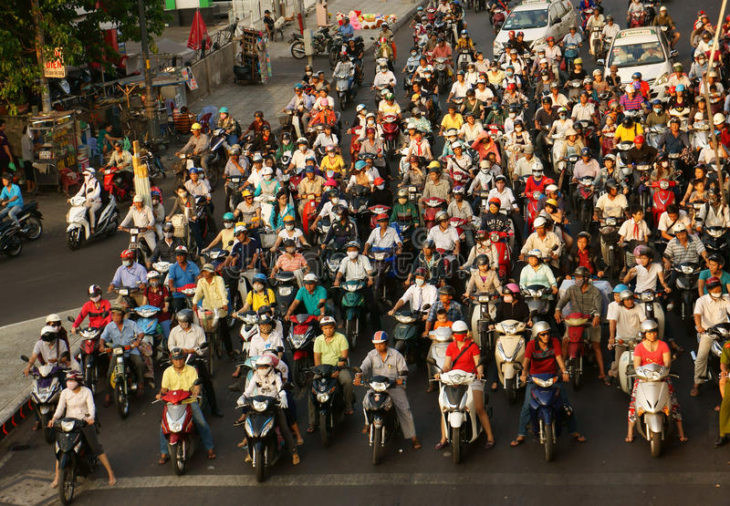Crowed urban traffic in rush hour Vietnam. HO CHI MINH CITY, VIET NAM- MAR 27: Amazing, crowed scene of urban traffic in rush hour, crowd of people wear helmet royalty free stock photos