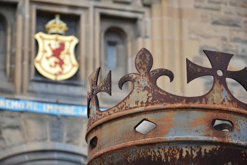 Crown in front of gate to Edinburgh Castle, Royal Stuart coat of arms in background, Scotland, United Kingdom. Sunny day stock photography