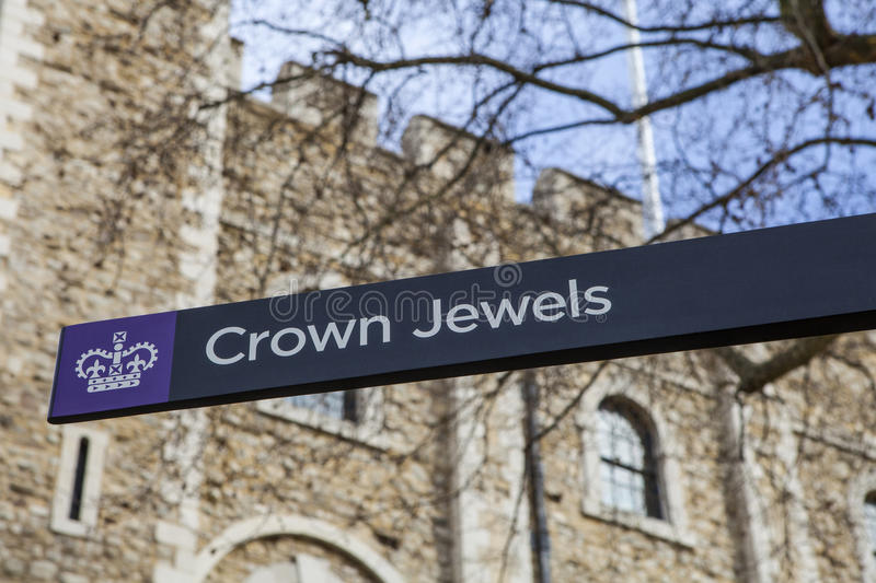 The Crown Jewels at the Tower of London. A sign pointing towards the location of the Royal Crown Jewels at the Tower of London royalty free stock photos