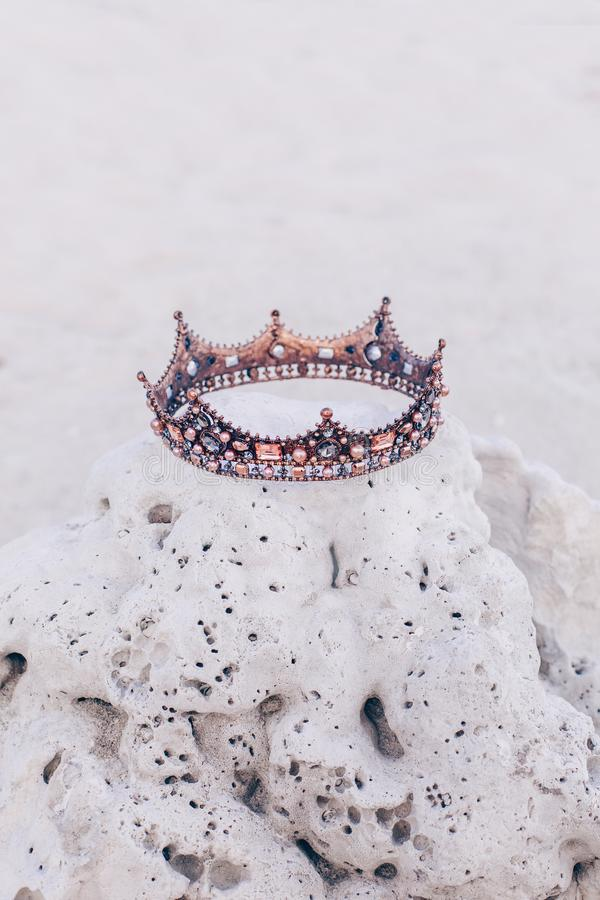 Crown lying on stone on the beach. Nobody stock photography