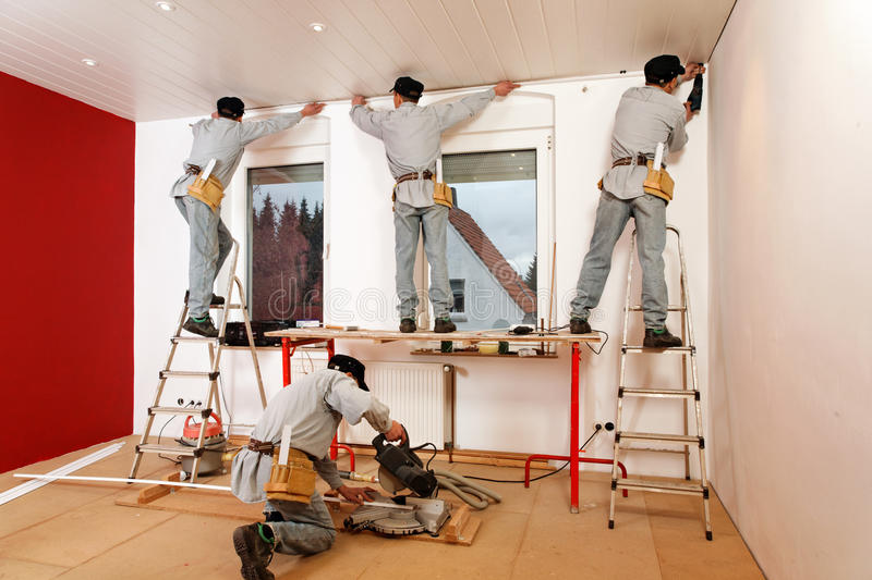 Crown Molding Installation. Installing Crown Molding on Living Room Ceiling royalty free stock photography