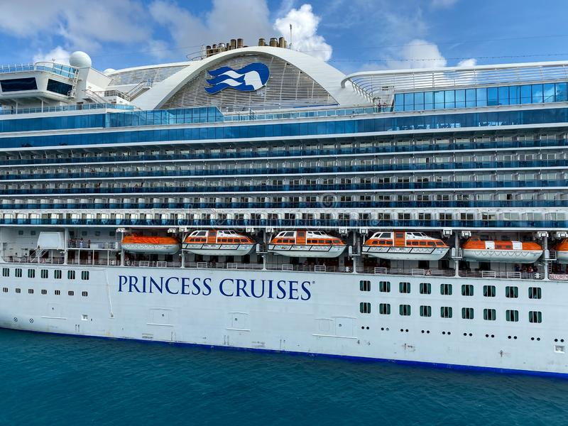 The Crown Princess cruise ship, is owned by Carnival Corporation, docked at Aruba on a sunny day with blue skies royalty free stock photos