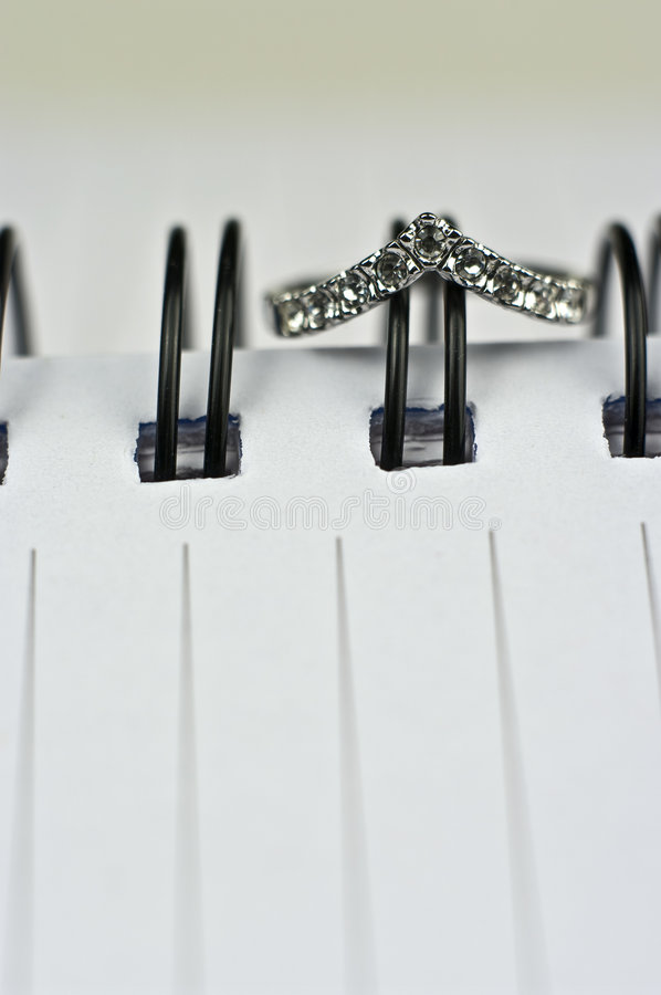 Download Crown ring notebook stock photo. Image of rings, blur - 7479152