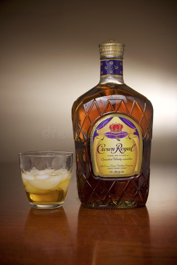 Crown Royal Canadian Whisky product shot. Product shot of a 1.5L bottle of Crown Royal Whisky and served on a glass with ice royalty free stock image
