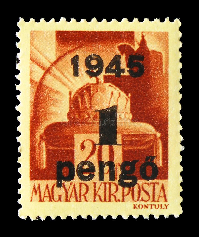 Crown of Saint Stephen, Surcharged serie, circa 1945. MOSCOW, RUSSIA - JULY 19, 2019: Postage stamp printed in Hungary shows Crown of Saint Stephen, Surcharged royalty free stock photography