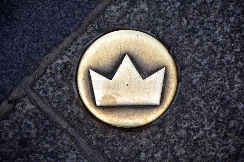 Crown as a symbol of the Coronation walk from Bratislava - Slovakia. Crown on the street marks the historic coronation walk through the old town of Bratislava royalty free stock image