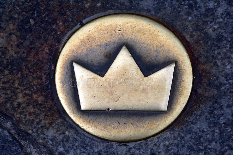 Crown as a symbol of the Coronation walk from Bratislava - Slovakia. Crown on the street marks the historic coronation walk through the old town of Bratislava stock photos