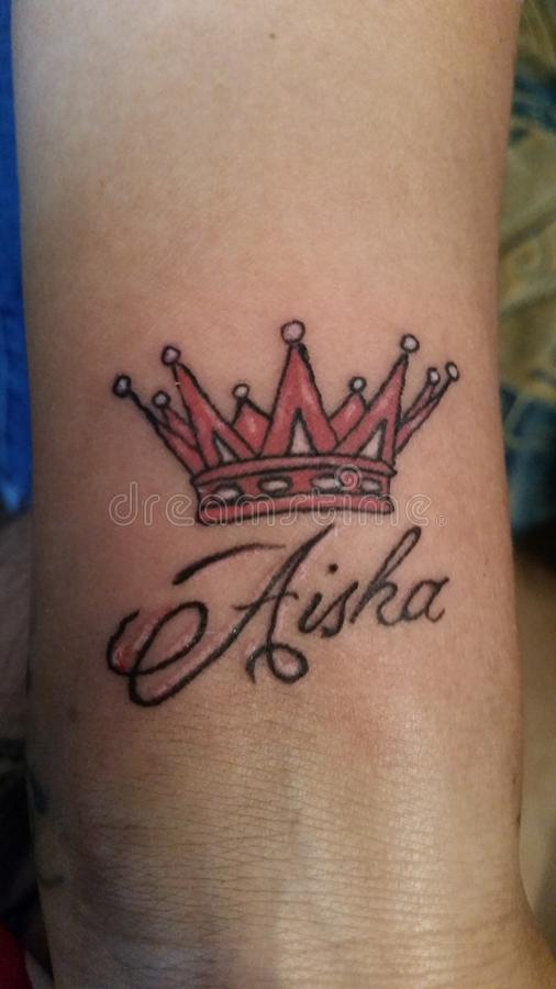Crown tattoo. Rose crown tattoo with name royalty free stock photos
