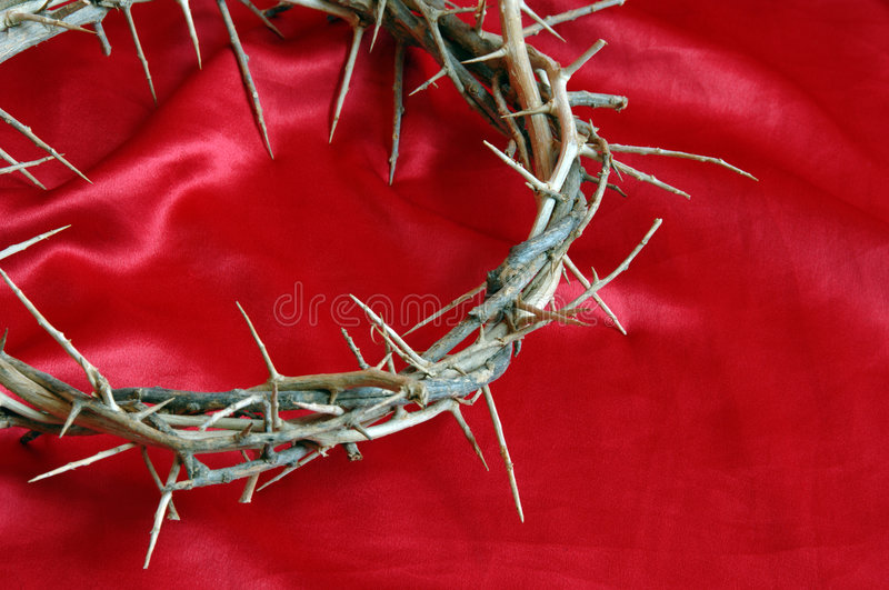 Crown on Thorns on Red Satin stock photos