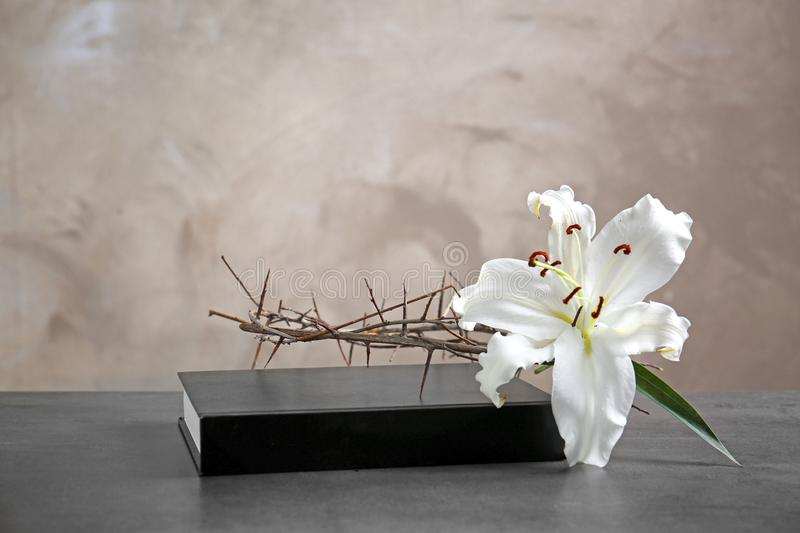 Crown of thorns, white lily and Holy Bible royalty free stock images