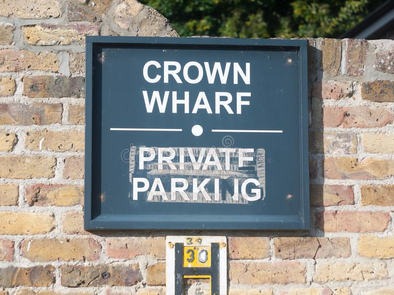 Crown wharf private parking road sign on wall. England; Essex stock photography