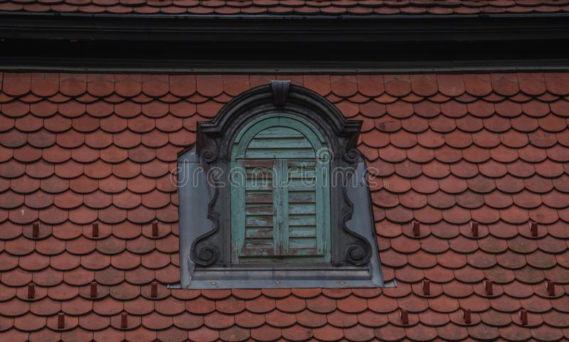 A crown window, old surrounded by tile royalty free stock image