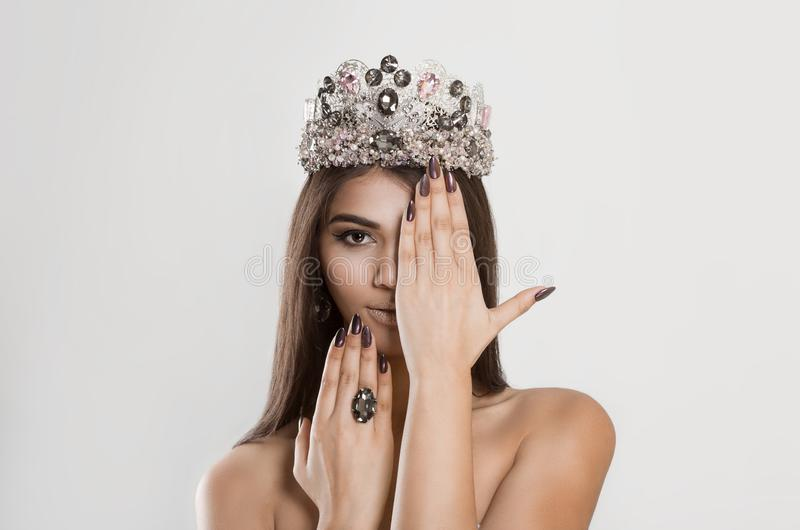 Crowned dark beauty queen. Brunette woman fashion model royalty free stock photography