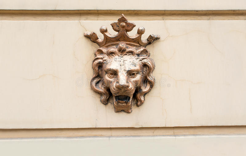 Crowned lion - a symbol of power. Figure of bronze lion on the facade. stock photography