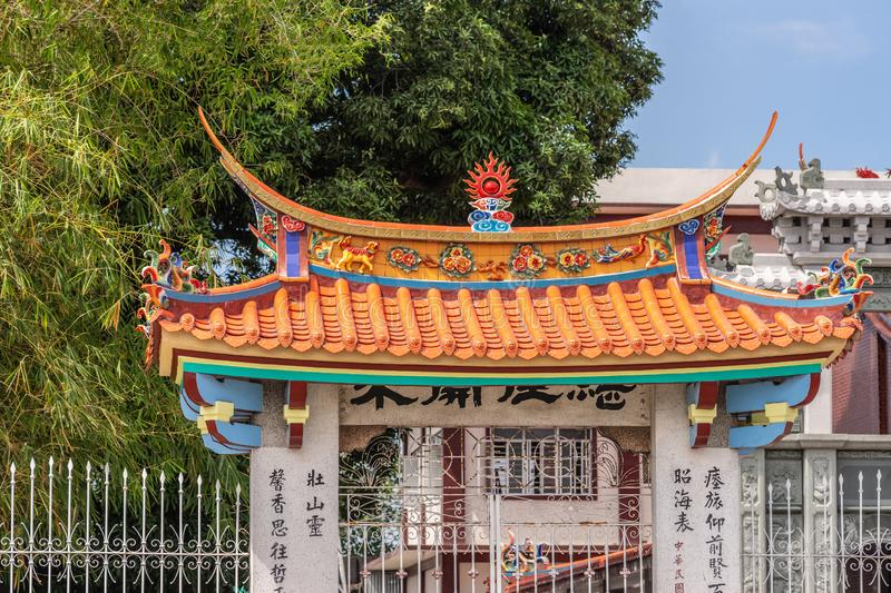 Crowning decoration on gate to temple at Chinese Cemetery in Manila Philippines. Manila, Philippines - March 5, 2019: Chinese Cemetery in Santa Cruz part of town royalty free stock image