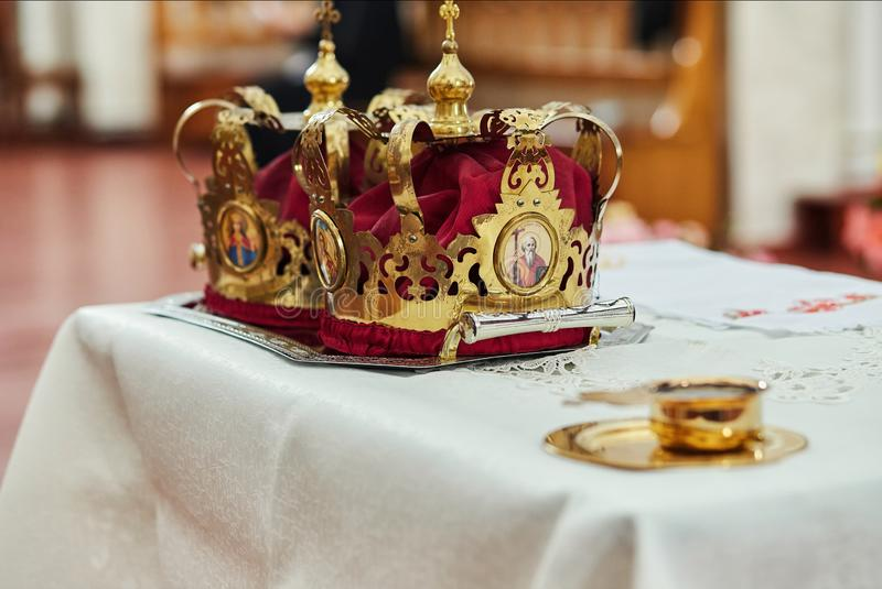 Crowns in church ready to wedding ceremony stock images