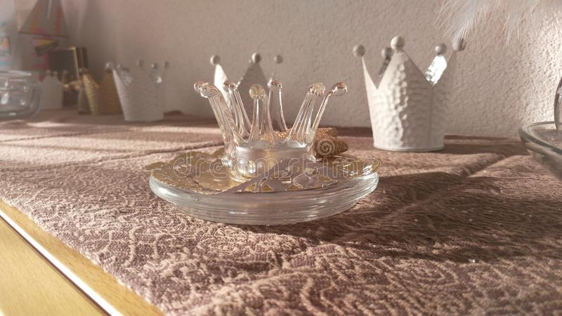 Crowns decoration on a table stock image