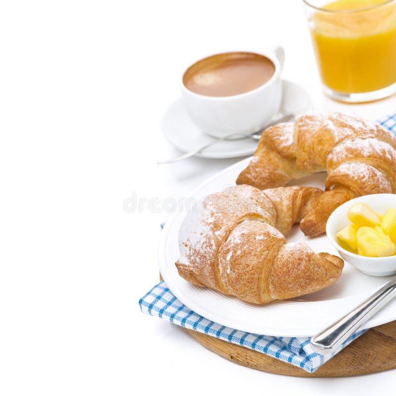 Cruasanes con mantequilla, café express y el zumo de naranja aislado foto de archivo