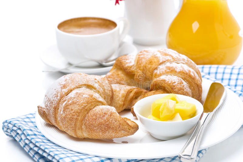 Cruasanes con mantequilla, café express y zumo de naranja para el desayuno imágenes de archivo libres de regalías