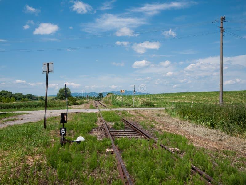 Cruce ferroviario rural fotografía de archivo libre de regalías