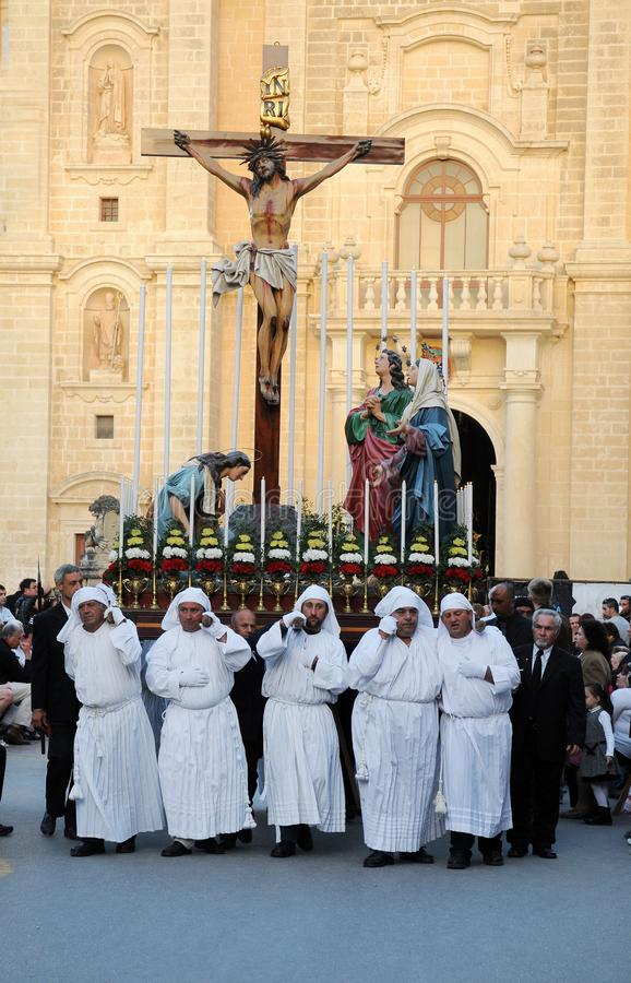 Crucified jesus carried by a team of ten porters. Good friday procession in Zerbbug. In Zebbug is the famous and longest procession in Malta that celebrates the