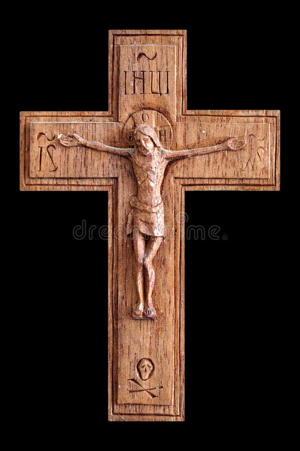 Crucifix. Wooden crucifix with skull and crossbones isolated on black background royalty free stock image