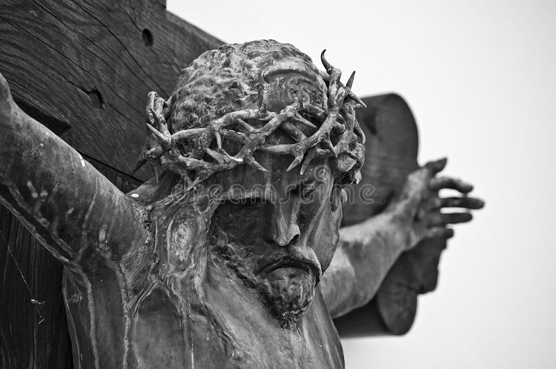 Crucifix. An olden crucifix on the wall of an ancient church stock images