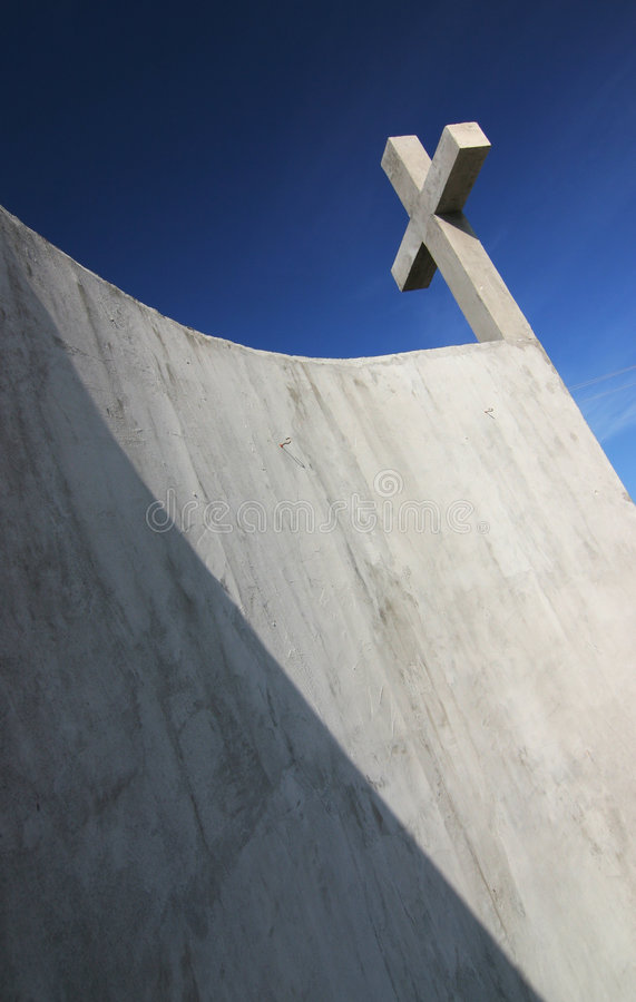 Crucifix. Concrete crucifix with nice blue sky royalty free stock image