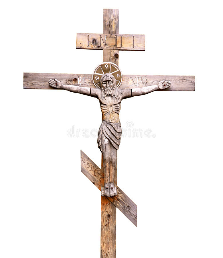Crucifix. Old-time wooden orthodox crucifix on white background royalty free stock photography