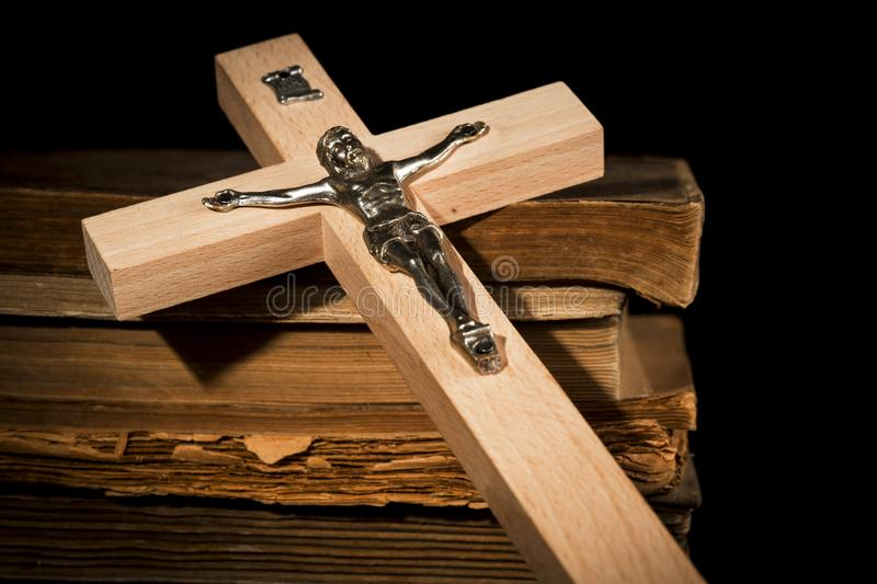 Crucifix against the background of books. On old boards royalty free stock photo