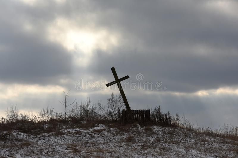 Crucifix against the background of a dramatic sky. holy, faith.  royalty free stock images
