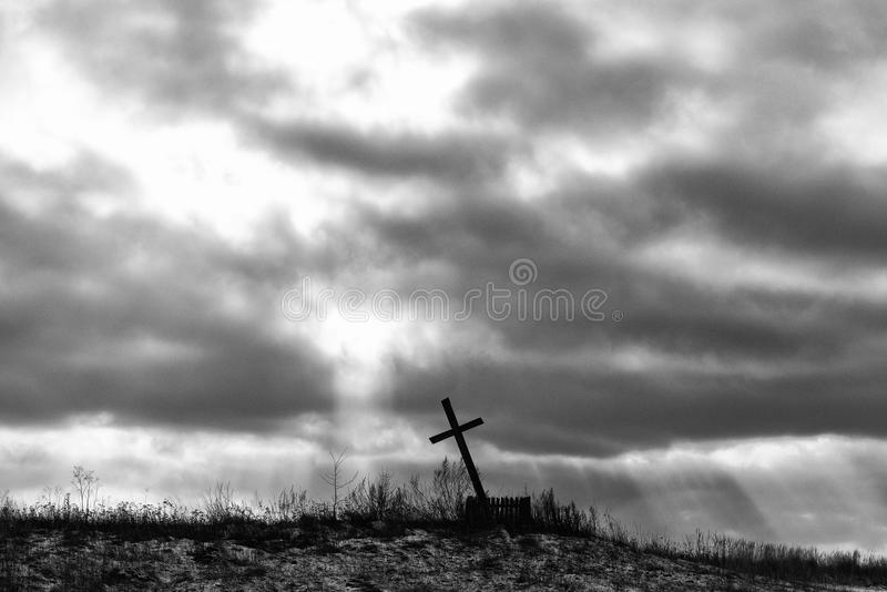 Crucifix against the background of a dramatic sky. holy, faith.  stock photography
