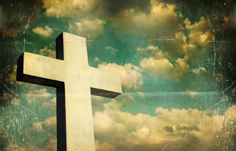 Crucifix. Artistic and vintage image of a Crucifix in the background a beautiful sky royalty free stock photos