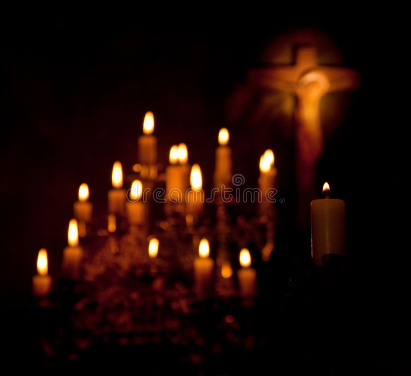 Crucifix and candles stock photography