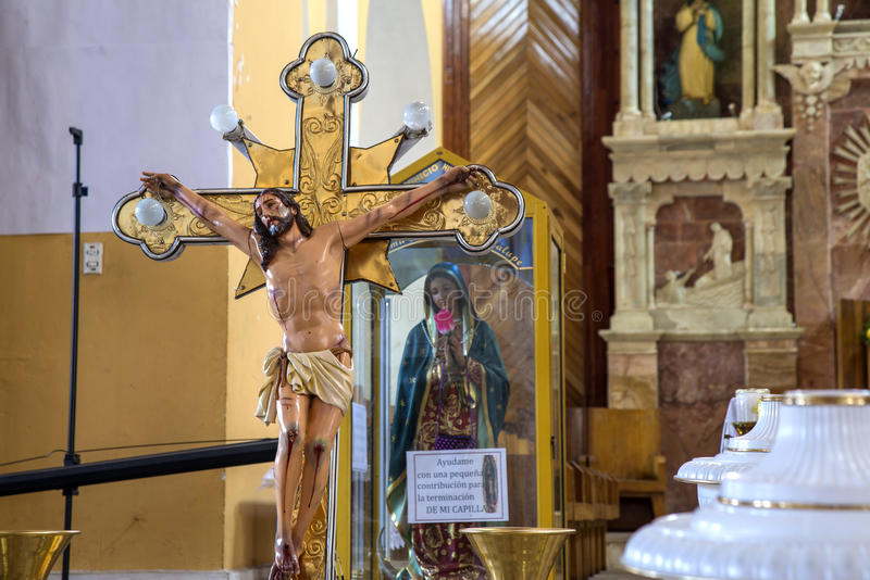 Crucifix in a Cathedral. Crucifix in the interior of the Cathedral of Guaranda, Bolivar Province, Ecuador royalty free stock image