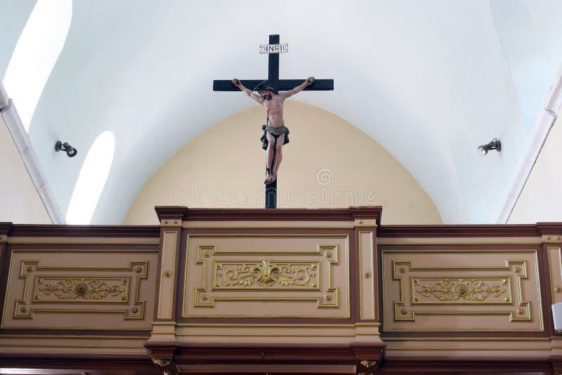 Crucifix on the choir in the Saint Martin Church in Zrnovo, Croatia. Crucifix on the choir in the Saint Martin Church in Zrnovo, Korcula island, Croatia stock photo