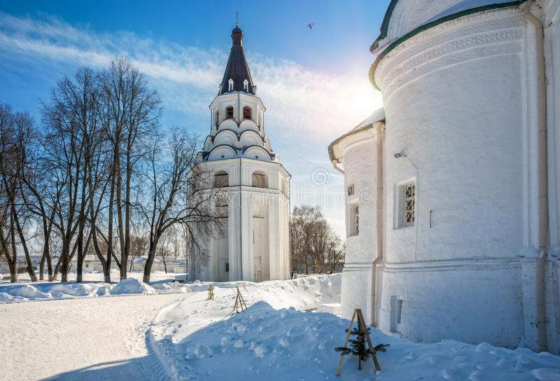 Crucifix church-bell tower in Alexandrov Sloboda. Against the background of blue sky and white snow stock photography