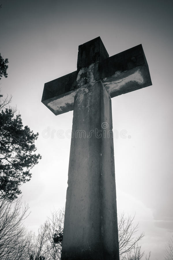 Crucifix. A cross on an old cemetery from the frog perspective royalty free stock images