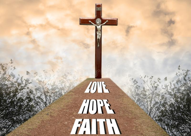Crucifix cross in the sky and faith hope love word for background and greeting cards or presentation. Or inspiration royalty free stock photo