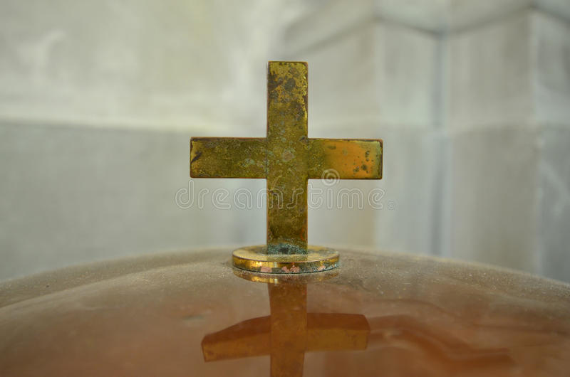 Crucifix. Detail of a crucifix on a baptismal font royalty free stock photos