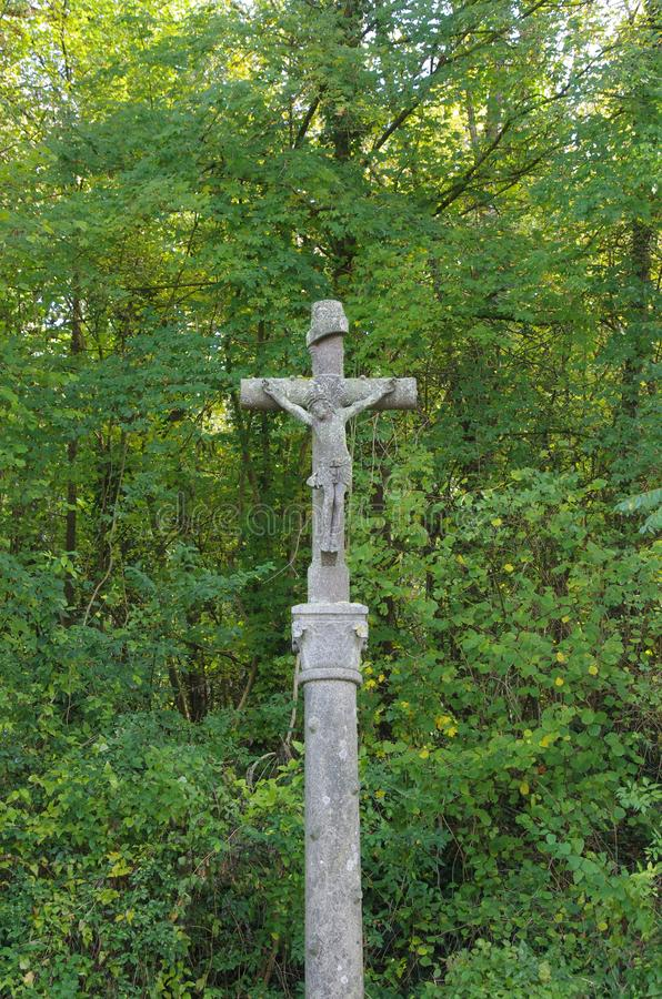 Crucifix in a forest near Paris in France, Europe. A crucifix in a forest near the city of Paris in France, Europe stock images